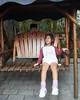 San Xi Swing Seat 26 (C & R Driver-Burgess) Tags: boy girl young small swing seat chains rock hanging play fun friends shorts maroon top push woman smile paving stone garden cafe courtyard 三溪村后花园