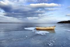 Frozen lake (radimersky) Tags: ice winter turawalake jezioro turawskie lód polska poland europa europe day dzień landscape krajobraz clouds niebo sky reflection odbicie zima łódka boat panasonic lumix dmclx100 lx100 microfourthirds 43 frozen february woda water tafla icedover icy