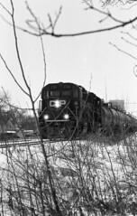day train (MarekSokal) Tags: mareksokal winnipeg traintracks train winter snow bw blackandwhite ilford hp5 pushedonestop epsonv600 canon canonfd ae1program