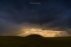 Storm over Tara (mythicalireland) Tags: storm clouds sky sun sunbeams cloud evening hill tara mound hostages meath ireland landscape weather dull dark megalithic monument neolithic prehistory ancient