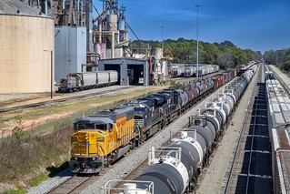NS 330 enters through Langdale Yard in Valdosta as one of the two ADMX SW14's works some hoppers in the background.