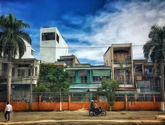 Saigon street scene (ValterB) Tags: seasia iphone valterb valter vietnam 2018 flickr holiday trip buildings exposure building architecture facadelines shadow abstract tiles shapes geometrical saigon urban urbanphotography sky blue cloud clouds people motobike moto helmet three palms palm built road street wires fence