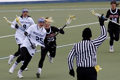 Right in front of the ref! (stephencharlesjames) Tags: womens sport college sports lacrosse action ncaa vermont wesleyan middlebury ball shirt pull stick