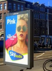 In the Spotlight (Quetzalcoatl002) Tags: pink street billboard advertisement sunglasses