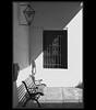 otro patio al sol (pilaraf14) Tags: patio courtyard museo museum monocromático monochrome sunlight shadows sol sombras banco bench emulaciónfílmicokodakbw400cn rawtherapee