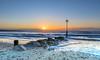 Sunrise Flare (nicklucas2) Tags: avonbeach seascape beach groyne isleofwight pebble sand sea seaside solent sun flare cloud