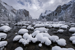 Snowy Gates and the Merced River (Kurt Lawson) Tags: california captain cathedral clouds copyrighted elcapitan ephemeral fresh granite merced mountains national park reflection river rocks sierra sierranevada snow snowballs storm trees valley water winter yosemite