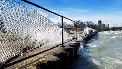 untitled (elaine layabout) Tags: chicago montrosedogbeach ice icicles waves fence spring