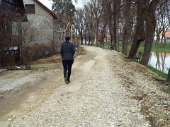 Petrinjcica River in Petrinja Croatia - March 2018 (sean and nina) Tags: petrinjcica river water stream flood flooded swollen fast current flow riverbank canal manmade channel trees spring thaw march 2018 petrinja croatia croatian hrvatska eu europe european balkan balkans nature natural outdoor outside walk walking brown bridge green grass public path pathway nina beauty beautiful gorgeous stunning charm charming black coat jeans clothes sunglasses pose posed posing woman female girl lady girlfriend fiancee wife happy married smile smiling