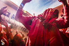 Captivated celebrations (Shikher Singh) Tags: holi garland roses widow lady vrindavan woman colours dancing smile love celebration shikher'simagery