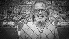 Escape to victory (KOSTAS PILOT) Tags: football soccer portait coach outdoor fence blackandwhite person kostaspilot sony sonyhx60 greeklife greece peloponese achaia face ελλάδα πελοπόννησοσ αχαιασ ποδόσφαιρο προπονητήσ sport πορτραίτο ασπρόμαυρη footballer