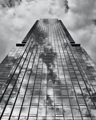 Looming tower (-liyen-) Tags: building architecture clouds reflection toronto ontario canada yorkville fujix100f challengeyouwinner cyunanimous