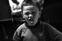 Mueca (hit_your_nightmares) Tags: child blackandwhite boy face grin mueca