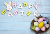colorful eggs in nest on blue wooden background and cookies lettering Happy Easter (lyule4ik) Tags: easter background nest wood spring white celebration colorful decoration holiday green design nature rustic closeup natural color decorative happy season seasonal traditional wooden eggs flower gift pattern retro table texture petals posy old empty symbol surface stone topview bouquet mother space valentine egg food vintage orange festive basket quail greeting