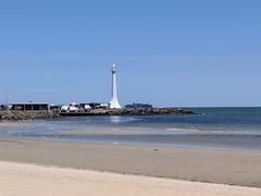 Lighthouse (Runi Lon) Tags: beach sea ocean lighthouse sand sky stkilda victoria australia oz summer swim floating takingitin bay boat water seagulls view
