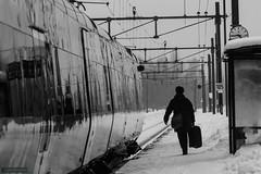 What is your goal? (kentkirjonen) Tags: suitcase järnväg railroad train tåg canon 80d sweden sverige dalarna steel stål window sigma 70200 apo test prov winter vinter snow snö cold kallt fön fönster bw svartvit person