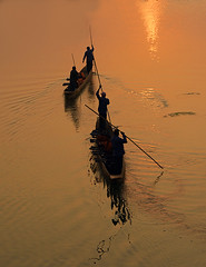 Starting Out (Aubrey Stoll) Tags: rapti river chitwan national park fishermen workers life jackets water reflections sunrise poles boats men nepal asia nature ripples sunlight morning sailing floating travel wooden silhouettes