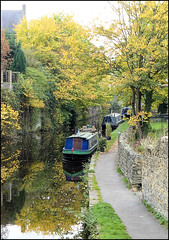 Autumn along the canal. (Country Girl 76) Tags: canal leeds liverpool springs branch skipton water autumn trees reflections towpath narrow boat blue building wall colours