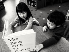 2018-03-14_01-19-12 (R. Huang 李) Tags: monroe public library kids reading book no pictures sister brother