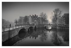 Canal Crossing (Vesa Pihanurmi) Tags: amsterdam holland netherlands dawn morning fog foggy mist trees road character canal keizersgracht reflection bridge cityscape