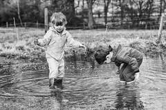 Had a lot of rain (jayneboo) Tags: twins ben norah grandchildren agethree fun puddles wellies wet weather field splash leica cl voigtlander nokton 40mm 12 manual bw mono kids children play playtime