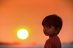 If we could all see the world through the eyes of a child, we would see the magic in everything. (charuthchand1) Tags: sunset childhood innocent beach beauty cute kerala india indian beachlove peace love