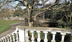 York House Gardens. Twickenham. Gr London. UK. (standhisround) Tags: yorkhouse twickenham greaterlondon london england uk trees plants flowers earlyspring gardens bridge footbridge stone wall japanesegarden scenic scene grass outdoors outside sunny shadows pond