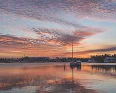 ballarddusk (vonclay) Tags: sunset river water clouds boat reflection florida