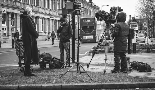 Traffic island film crew