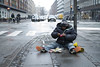 Homeless on the street (' A r t ') Tags: homeless copenhagen man breakfast sno snow wet street car cars eating mackerel tomato sauce buns dof field depth raod road pavement sidewalk