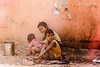 My Brothers Keeper_Boys in India (mraderstorf) Tags: rocks street dusty texture dirty baby bucket nikond700 gutter smiling india boys nikon28300mmvr