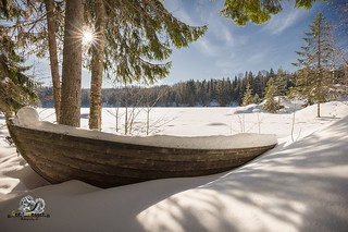 boat and sun flares in the winter
