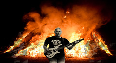 I am the god of hell fire, and I bring you! Fire. (Neil. Moralee) Tags: neilmoralee man fire blaze burning bass player guitar music dark barnone neil moralee nikon d7200 taunton somerset band group inferno blackbackground layer night colour color
