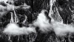 The Solid and the Soft... (Ody on the mount) Tags: abstrakt anlässe berge details dolomiten em5ii felsen fototour gipfel italien langkofel langkofelgruppe omd olympus rahmen südtirol urlaub wolken workshop bw clouds monochrome mountains rock sw