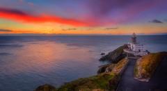 Baily Lighthouse (Michał.Włodarczyk) Tags: ireland howth lighthouse sea sun light water rocks beautiful seascape