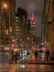 Looking North on Fifth (Jeffrey Friedkin) Tags: jeffreyfriedkinphotography architecture buildings cityscene cityscape empirestatebuilding iconic skyline manhattan newyork nyc newyorkphoto night newyorkscene rain red