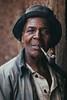 Rwandan Uncle (Alex E. Proimos) Tags: rwandan uncle pipe man portrait award winning prize first