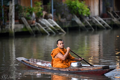 Collecting Alms (D. R. Hill Photography) Tags: monk orangerobes buddhist buddhism boat canal river travel thailand amphawa asia southeastasia streetphotography candid bokeh khlong klong thai alms water nikon nikond750 d750 nikon80200f28 80200mm