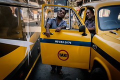Untitled (koushiksinharoy1) Tags: streetphotography kolkata india emotion expression lines colour portrait faces bus taxi cab afternoon spring yellow leadinglines bodylanguage framewithinaframe streets candid