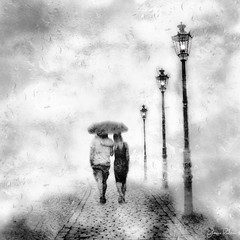 embracing the rain . . . (YvonneRaulston) Tags: rain raindrops lamp lights umbrella people couple wet cobblestones blackandwhite bw bokeh clouds fog mist shower atmospheric art creativeartphotography calm creative dream emotive embrace texture fineartgrunge figures glow impressionist impact moody moments old soft sony path photoshopartistry peaceful surreal together mysterious