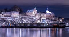Akershus Festning (b.adolphi) Tags: oslo norway akershus festning fortress night water winter snow magenta building sky