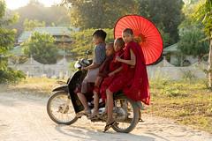 Way about town (Kathy~) Tags: transportation bike monks novicemonks four 4 fc red myanmar burma