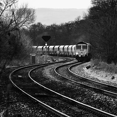 Rounding the Curves (powern56) Tags: gloucestershire lydney naascrossing levelcrossing freightliner class66 66544 4e42 freighttrain railway diesellocomotive curves monochrome blackwhite