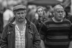 At the fair (Frank Fullard) Tags: frankfullard fullard candid stret portrait pair monochrome blackandwhite blanc noir hard char tough men cap fair irish ireland