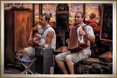 the music men of Collioure (France) (Bobinstow2010) Tags: france pyrenees music accordion guitar men male amplifier restaurant street frame topaz photoshop collioure