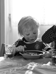 Jakob (livsillusjoner) Tags: blackwhite blackandwhite black white grey monochrome toddler kid kids child children cute young boy boys eat eating porridge drink
