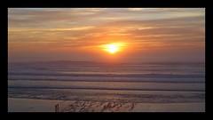 Oregon Coast Sunset (Eclectic Jack) Tags: 7dwf sunset oregon coast ocean beach sky sand water people dusk candid color colorful yellow orange wave cloud