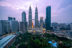 Cityscape of Kuala Lumpur Panorama at twilight. Panoramic image of skyscraper at Kuala Lumpur, Malaysia skyline at sunset. (MongkolChuewong) Tags: architecture asia asian blue building business capital center city cityscape dark district downtown dusk evening famous home house kl klcc kuala landmark landscape lumpur malaysia malaysian modern night office panoramic petronas place reflection scene sky skyline skyscraper summer sunrise sunset technology tower towers travel traveler traveller twilight twin urban view