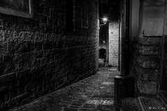 It's Dark Outside (SirakoM) Tags: piran pirano slovenia slovenija istra istria blackandwhite bw monochrome shadow street city dark night lamp stone narrow wall old medieval culturalheritage