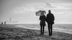 De Haan - Umbrella couples - B&W (Drummerdelight) Tags: beach seaside blackwhite shillouettes dehaan cloudy peoplewatching